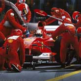 The Ferrari team undertake a pitstop at the 2000 United States Grand Prix at Indianapolis Motor Speedway. Michael Schumacher is the driver